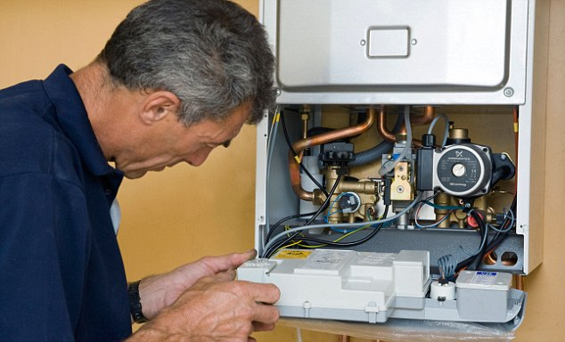 man working on a gas boiler. Image shot 2008. Exact date unknown.